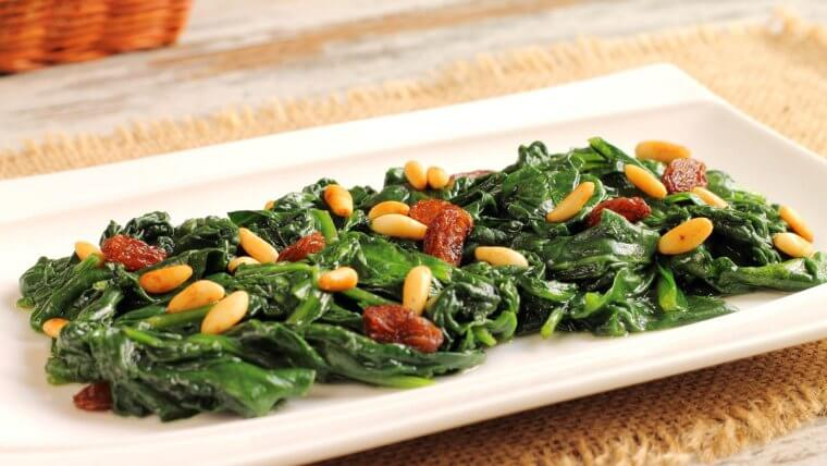 Sautéed Greens with Pine Nuts and Raisins - Wozupi Tribal Gardens