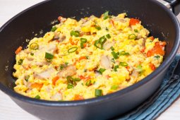 Scrambled Eggs with Fresh Corn, Goat Cheese, and Oven-Roasted Tomatoes